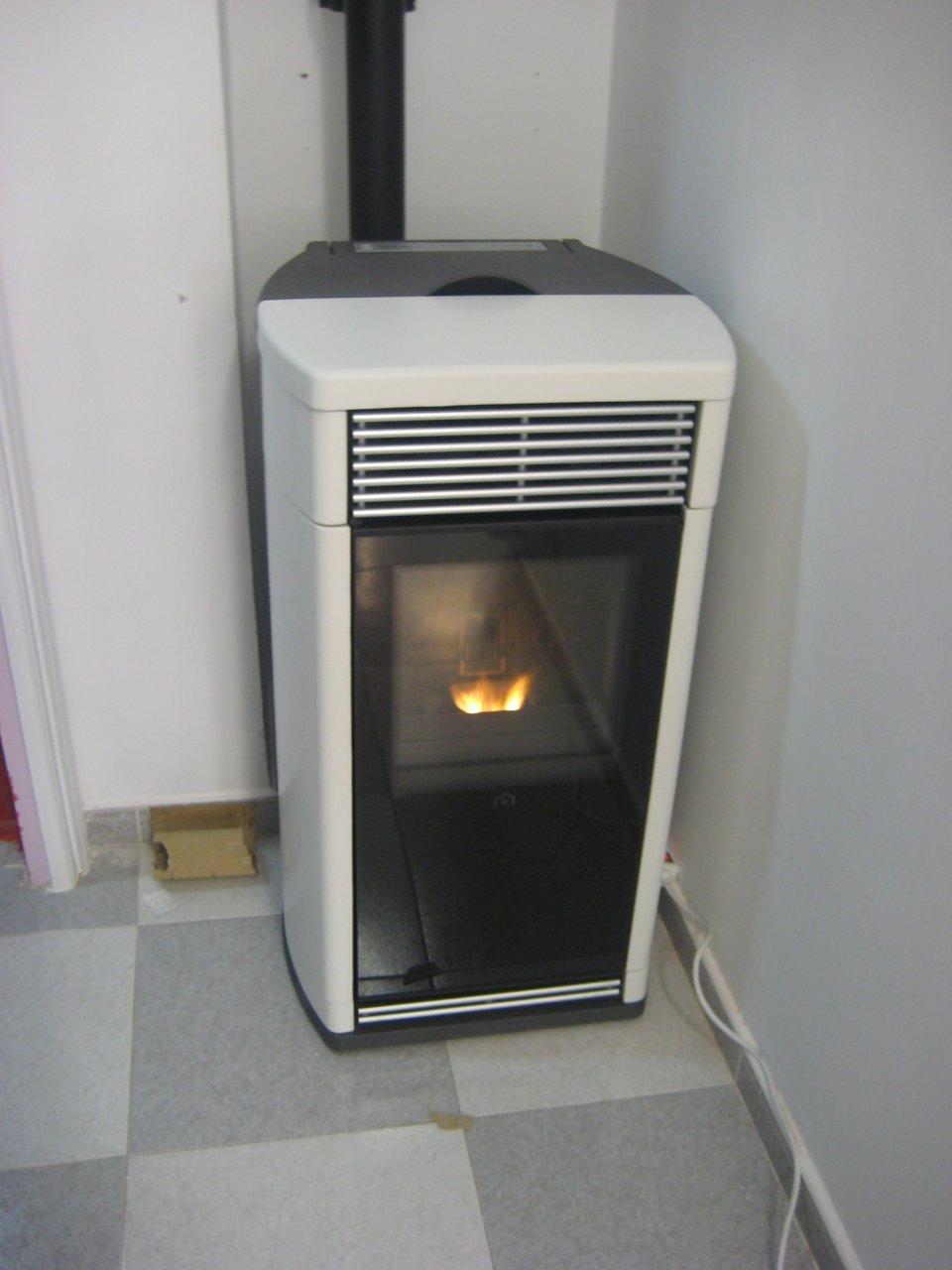Casas cocinas mueble instalacion de estufas de pellets - Que es una estufa de pellets ...